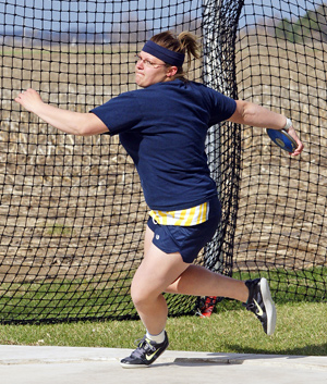Meaghan Foster (shown throwing the discus) became William Penn's second national qualifier with a shot put of 43-5.25