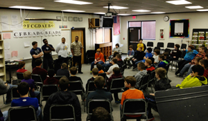 Team members met with middle school boys to talk about respect towards others